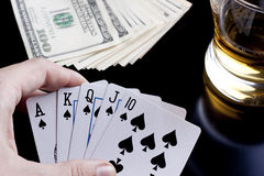 Poker night. Poker playing cards whiskey and some money on a table with reflection Stock Photography