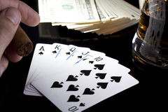 Poker night. Poker playing cards whiskey and some money on a table with reflection Royalty Free Stock Image