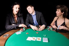 Poker night. Friends playing poker in the casino at night Stock Photo