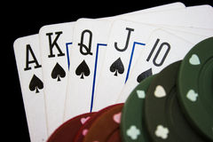 Poker night. Cards laying around with poker chips on top royalty free stock image