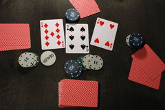 Poker play. Chips and cards. Texas holdem game royalty free stock image
