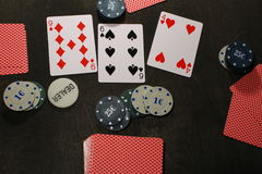 Poker play. Chips and cards. Texas holdem game royalty free stock photography