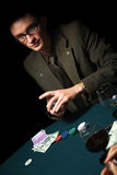 Poker player. Handsome young adult man mixing cards Royalty Free Stock Photography
