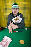 Poker player. An inveterate cardsharper playing poker royalty free stock photography