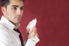 Poker player with aces and an ace in his sleeve Royalty Free Stock Images