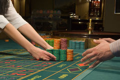 Poker player and a big pile of chips Stock Image
