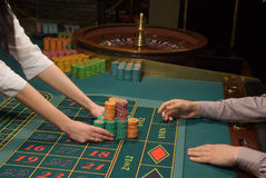 Poker player and a big pile of chips Royalty Free Stock Images