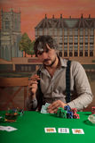 Poker player with cards. Poker player looked at their cards Royalty Free Stock Photography
