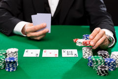 Poker player with cards and chips at casino Stock Photo