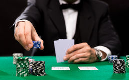 Poker player with cards and chips at casino Royalty Free Stock Photography
