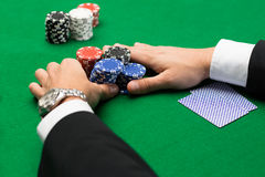 Poker player with cards and chips at casino Royalty Free Stock Images