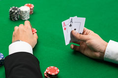 Poker player with cards and chips at casino Royalty Free Stock Photos