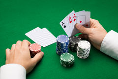 Poker player with cards and chips at casino Stock Photos