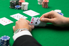 Poker player with cards and chips at casino Royalty Free Stock Image