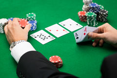 Poker player with cards and chips at casino Royalty Free Stock Photo