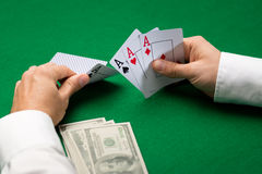 Poker player with cards and money at casino Stock Photo