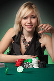 Poker player in casino with cards and chip. S on green background stock photography