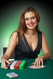 Poker player in casino with cards and chips Royalty Free Stock Photography