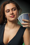 Poker player in casino with cards and chips Stock Photo