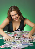 Poker player in casino with cards and chips Royalty Free Stock Image