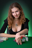 Poker player in casino with cards and chipsv Stock Image