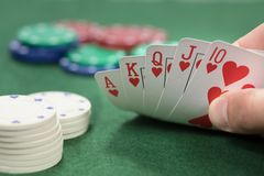 Poker player checking his royal straight flush Royalty Free Stock Photos