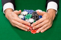 Poker player with chips at casino table Royalty Free Stock Photo
