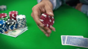 Poker player with chips stock video footage