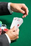 Poker player with full house on hands Stock Photos