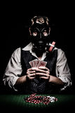 Poker player with a gas mask on his head Royalty Free Stock Image