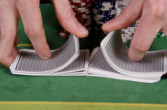 Poker player give the cards a shuffle Stock Images