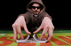 Poker player give the cards a shuffle Royalty Free Stock Image