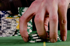 Poker player give the chips a shuffle Stock Image