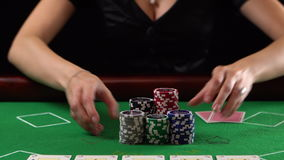 Poker player goes all-in and showing two aces. Concept of gambling, risk, luck, win, fun, and entertainment. Prores 4k. stock footage