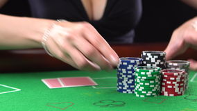 Poker player goes all-in and showing two aces. Concept of gambling, risk, luck, win, fun, and entertainment. Prores 4k. Poker player goes all-in and showing two stock video footage