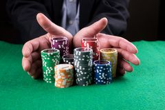 Poker Player Going `all In` Pushing His Chips Forward Stock Image