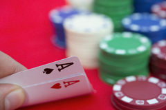 Poker player holding two aces Stock Photo