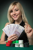 Poker Player In Casino With Cards And Chip