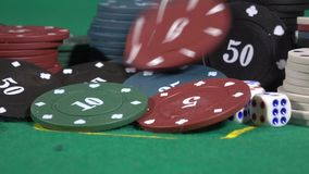 Poker player increasing his stakes throwing tokens gaming table. stock footage