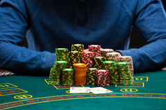 Poker player looking at combination of two aces. Closeup Stock Photography