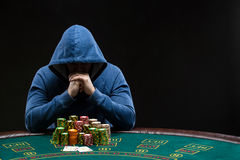Poker player looking at combination of two aces. Closeup Royalty Free Stock Photography