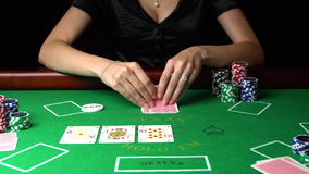 Poker player looking at her cards and checks. Concept of gambling, risk, luck, win, fun, and entertainment. Prores 4k. stock video