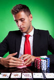 Poker player looking at his cards Royalty Free Stock Photos