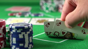 Poker player looking at his cards and checks. Concept of gambling, risk, luck, win, fun, and entertainment. Prores 4k. stock video
