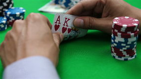 Poker player looks at card stock video