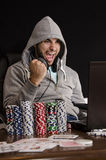 Poker player online victory isolated on black Stock Photography