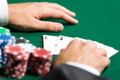 Poker player opens his poker cards Royalty Free Stock Photography