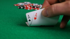 Poker Player with Pocket Aces Considering His Move stock video footage