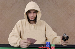 Poker player pointing gun Royalty Free Stock Images