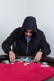 Poker player rakes and stacks chips. Poker player rakes in chips and starts to stack them Royalty Free Stock Photography
